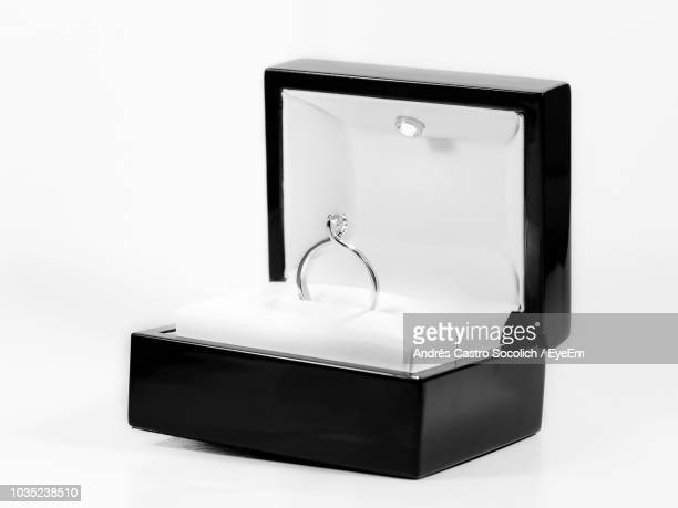 Close-Up Of Diamond Ring Jewelry Box On White Background
