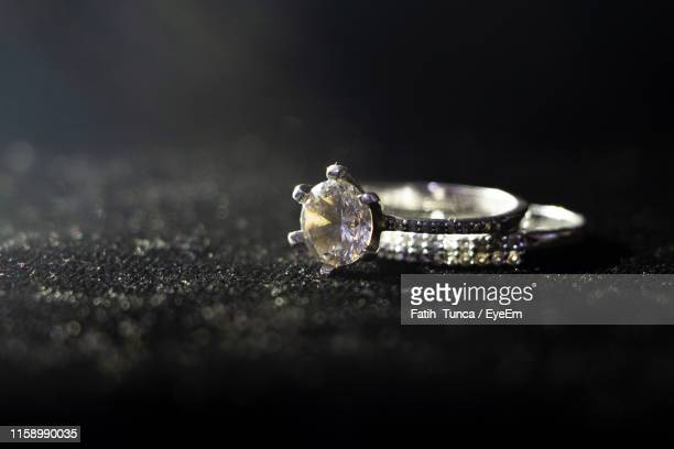 close-up of diamond ring on table - platinum rings stock pictures, royalty-free photos & images