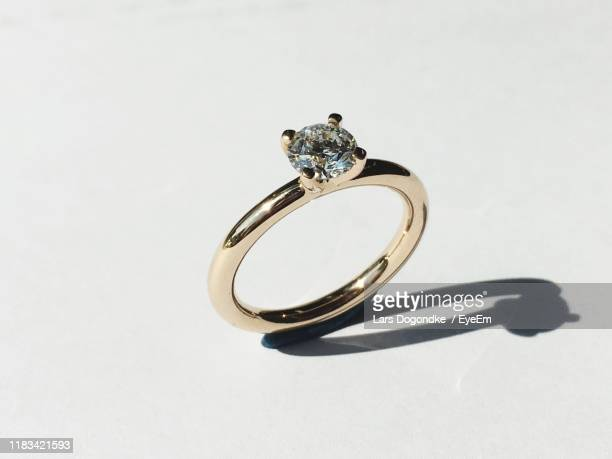 close-up of diamond ring on table - jewellery stock pictures, royalty-free photos & images