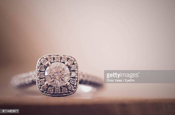 Close-Up Of Diamond Ring On Table