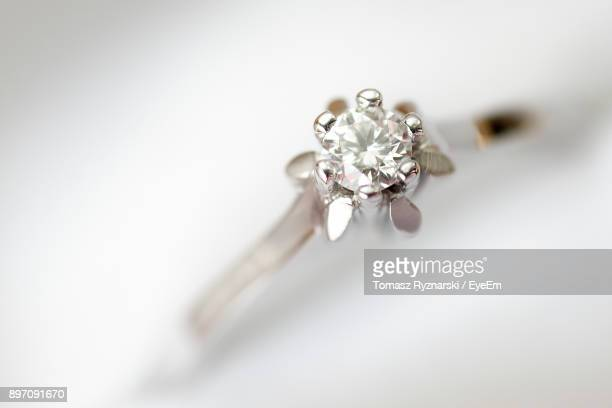 Close-Up Of Diamond Ring Over White Background