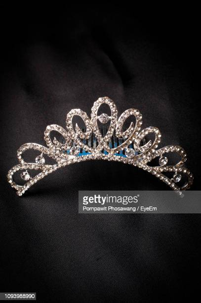 close-up of diamond tiara on black textile - crown close up stock pictures, royalty-free photos & images