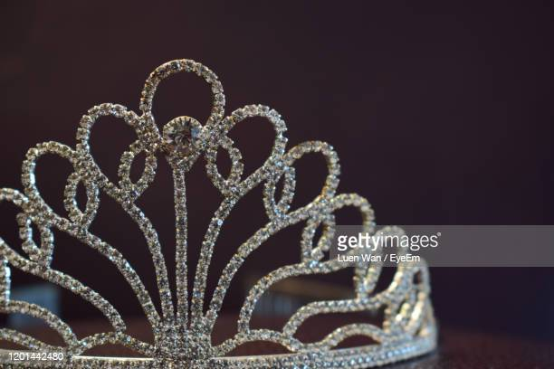 close-up of diamond tiara on table against black background - tiara stock pictures, royalty-free photos & images
