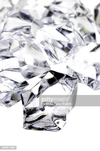 Close-Up Of Diamonds On White Background