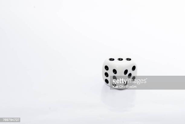 Close-Up Of Dice Over White Background