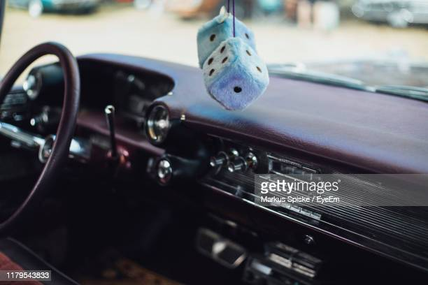 close-up of dice shaped decoration hanging in vintage car - car decoration stock pictures, royalty-free photos & images