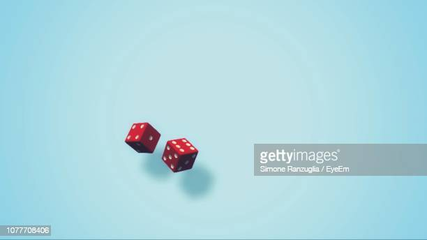 close-up of dices on blue background - dice stock pictures, royalty-free photos & images