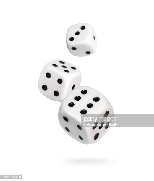 close-up of dices over white background - dice stock pictures, royalty-free photos & images