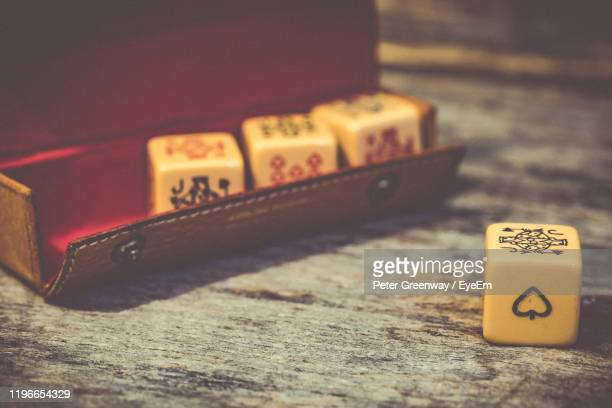 close-up of dices with drawing on table - bicester village stock pictures, royalty-free photos & images