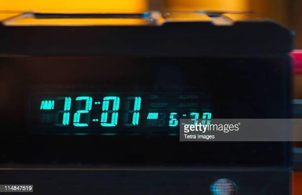 close-up of digital alarm clock - 12 o'clock stock photos and pictures