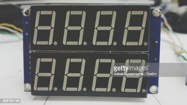 close-up of digital clock on table - digital clock stock photos and pictures