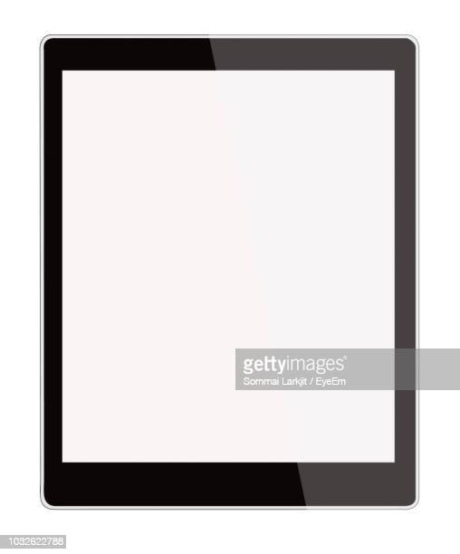 close-up of digital tablet against white background - pc ultramobile foto e immagini stock