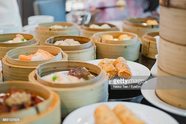 Close-Up Of Dim Sums Served In Steamers On Table