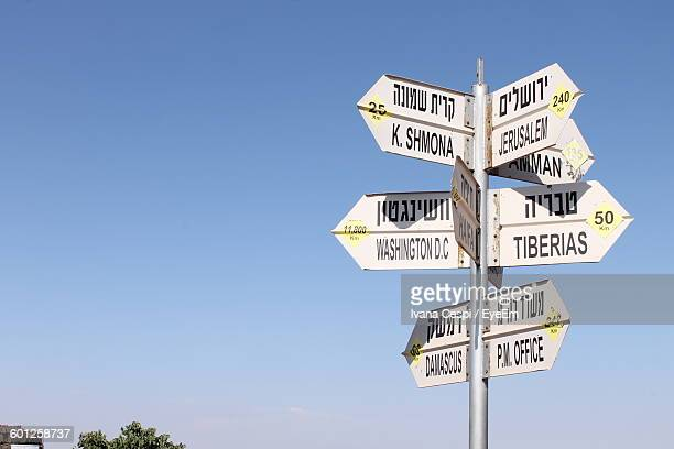 Close-Up Of Directional Signs Against Clear Sky