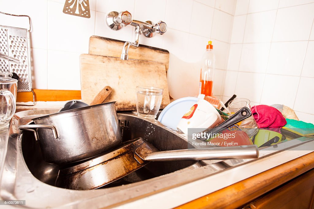 Closeup Of Dirty Dishes In Kitchen Sink Stock Photo | Getty Images