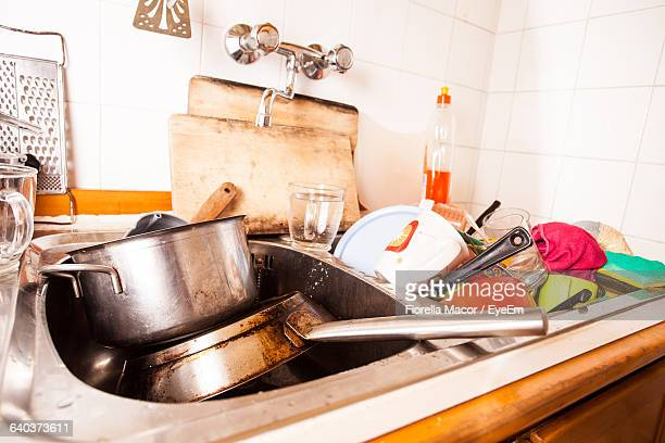 Close-Up Of Dirty Dishes In Kitchen Sink