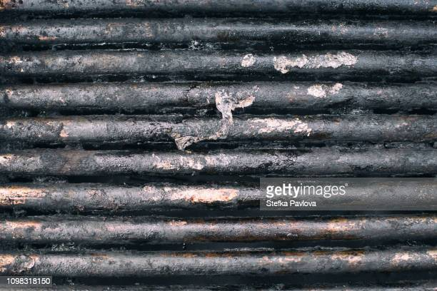 close-up of dirty used barbecue grill - metal grate stock pictures, royalty-free photos & images