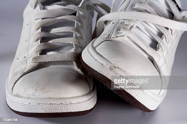 Close-up of dirty white sports shoes