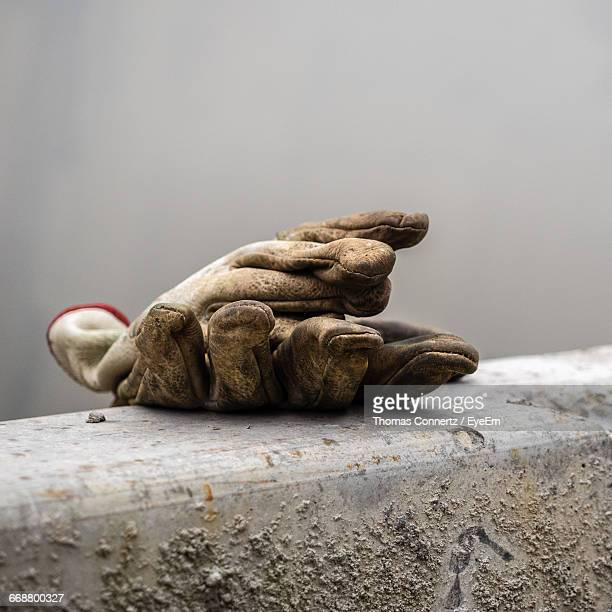 close-up of dirty work gloves - work glove stock photos and pictures