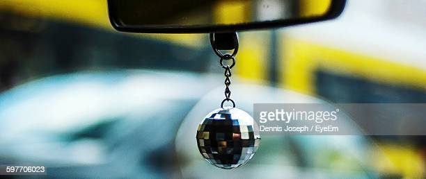 Close-Up Of Disco Ball Hanging In Car