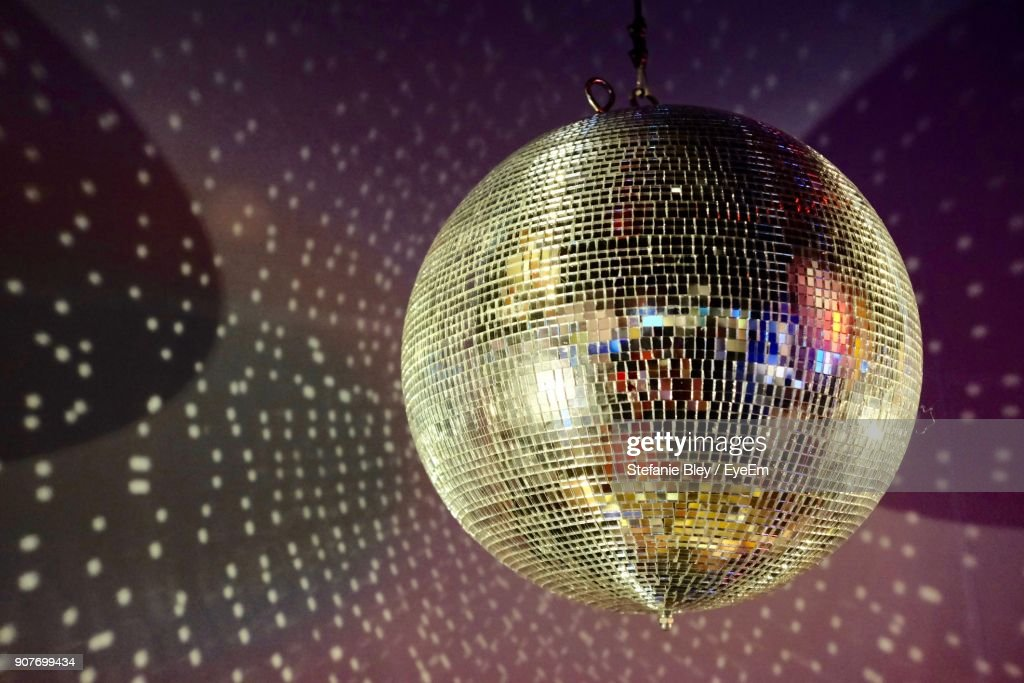 Close-Up Of Disco Ball Hanging On Ceiling : Stock Photo