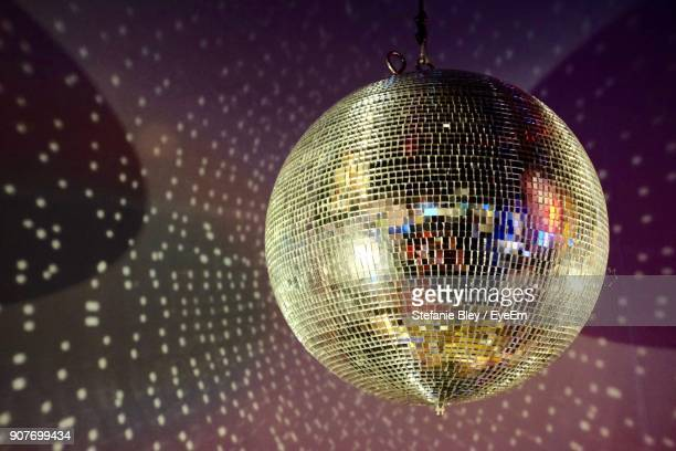 close-up of disco ball hanging on ceiling - disco ball stock photos and pictures