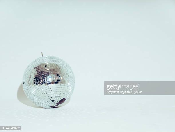 close-up of disco ball on white background - mirror ball stock pictures, royalty-free photos & images