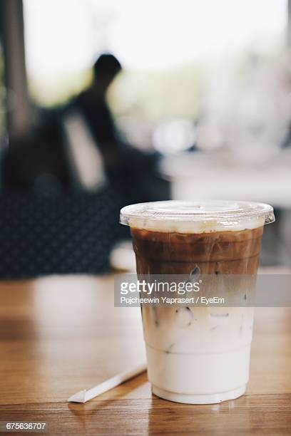 Close-Up Of Disposable Coffee Cup On Table
