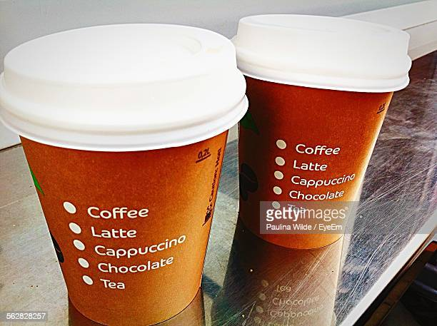 Close-Up Of Disposable Coffee Cups On Table