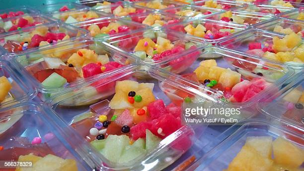 Close-Up Of Disposable Containers With Fresh Tropical Fruit Salad