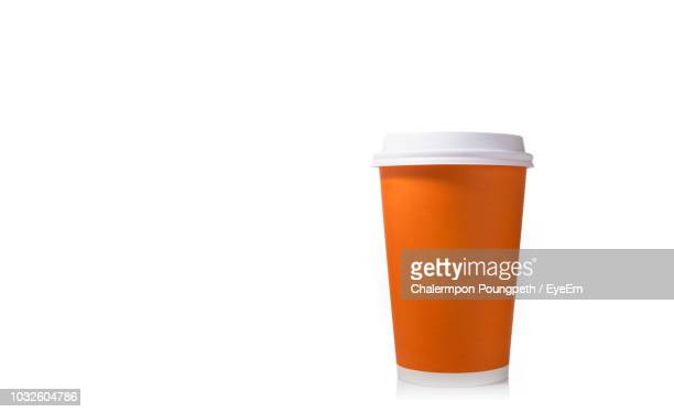 close-up of disposable cup against white background - disposable cup stock pictures, royalty-free photos & images
