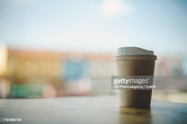 close-up of disposable cup on table - disposable cup stock pictures, royalty-free photos & images
