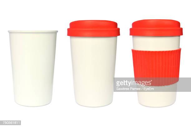 close-up of disposable cups against white backgrounds - disposable cup stock pictures, royalty-free photos & images