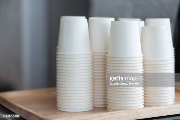 close-up of disposable cups on table - disposable cup stock pictures, royalty-free photos & images