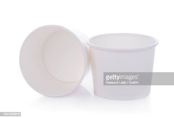 close-up of disposable cups over white background - disposable cup stock pictures, royalty-free photos & images
