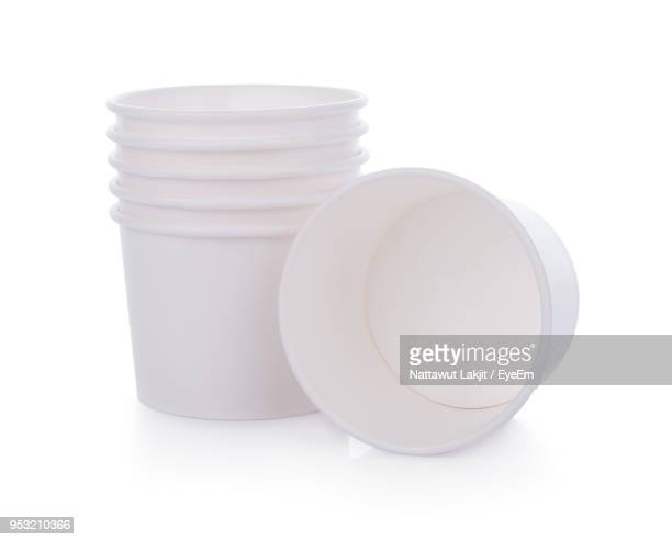 Close-Up Of Disposable Cups Over White Background