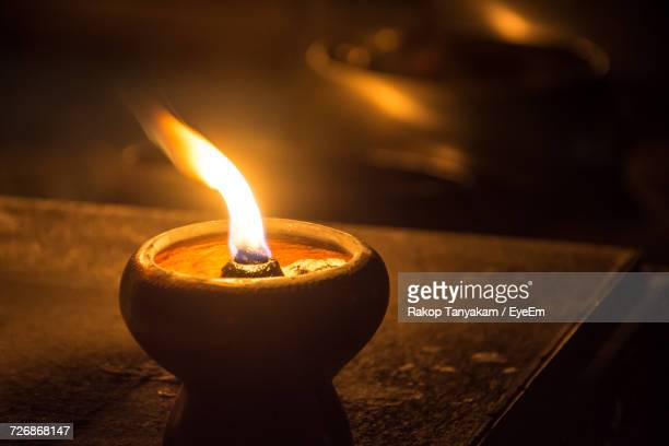 close-up of diya burning in dark - oil lamp stock pictures, royalty-free photos & images