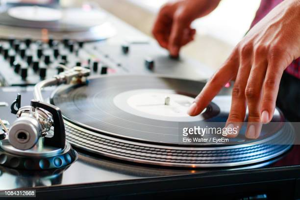 close-up of dj playing record - deck stock pictures, royalty-free photos & images
