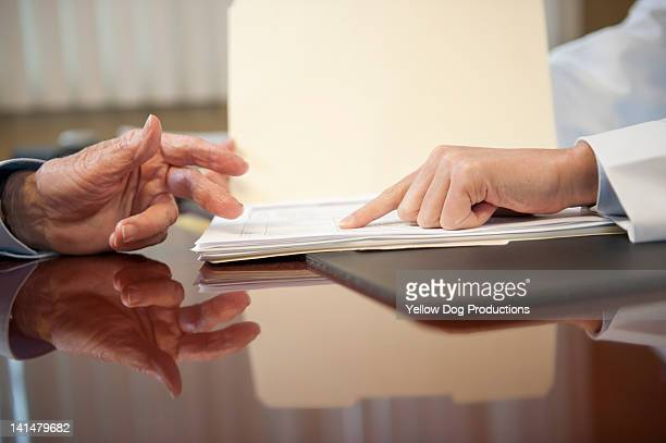 close-up of doctor and elderly patient's hands - aiming stock pictures, royalty-free photos & images