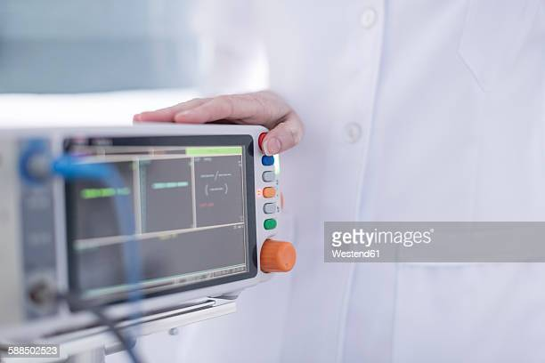 Close-up of doctor and patient monitor