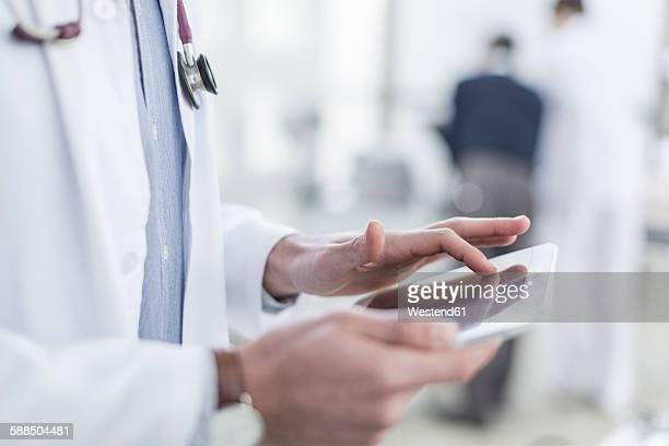 Close-up of doctor using a digital tablet