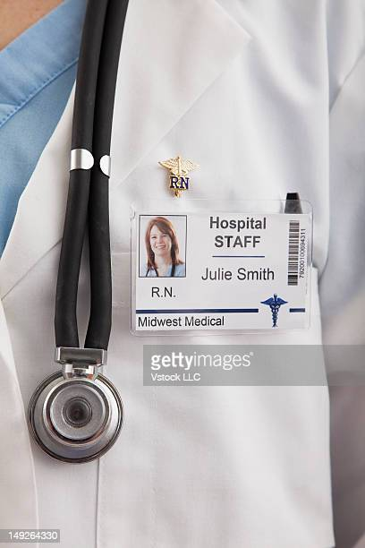 close-up of doctor's coat with name tag - name tag stock photos and pictures