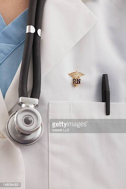 Close-up of doctor's coat with pen and stethoscope