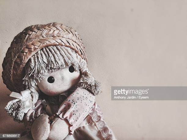 Close-Up Of Doll Against Wall