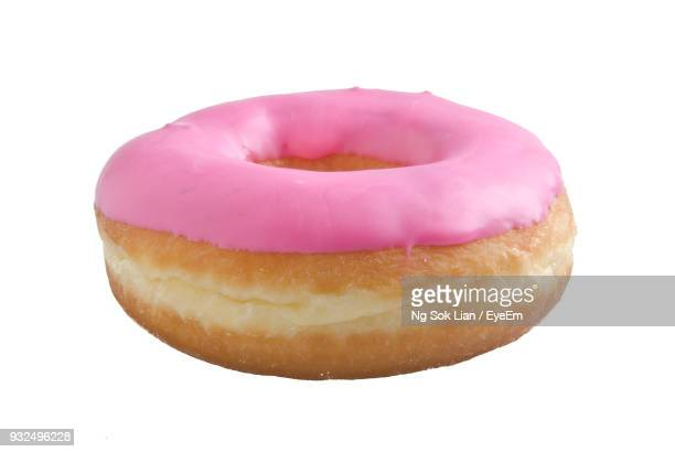 close-up of donut against white background - donut stock pictures, royalty-free photos & images