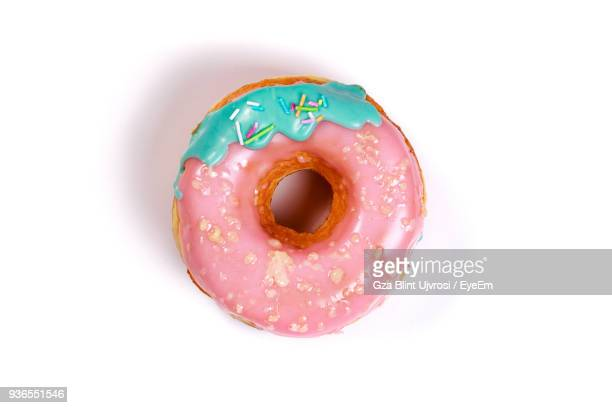 Close-Up Of Donut Against White Background