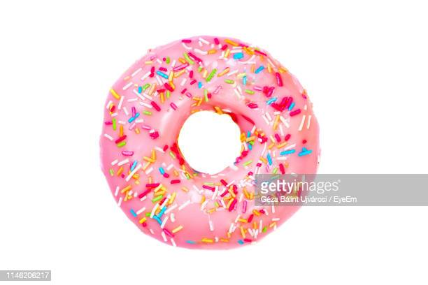 close-up of donut on white background - donut stock pictures, royalty-free photos & images
