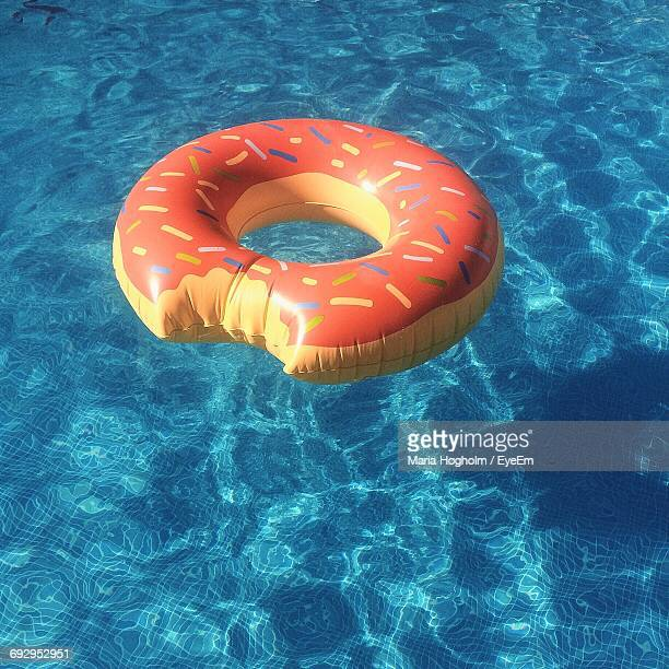 Close-Up Of Donut Shaped Inflatable Ring On Swimming Pool