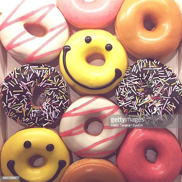 close-up of donuts in container - smiley face stock pictures, royalty-free photos & images
