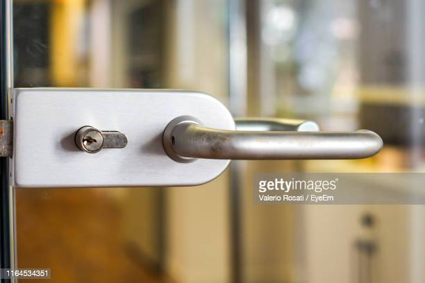 close-up of door handle - handle stock pictures, royalty-free photos & images